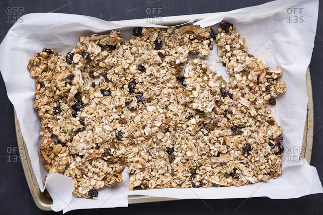 Coconut granola bark on a baking tray
