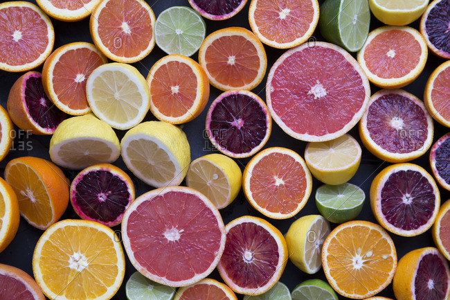 Variety of halved citrus fruits