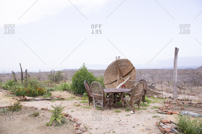 Desert landscape with patio table and chairs