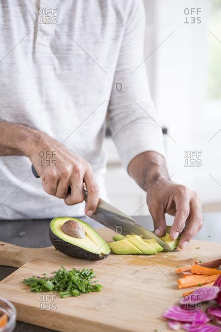 Man slicing avocado