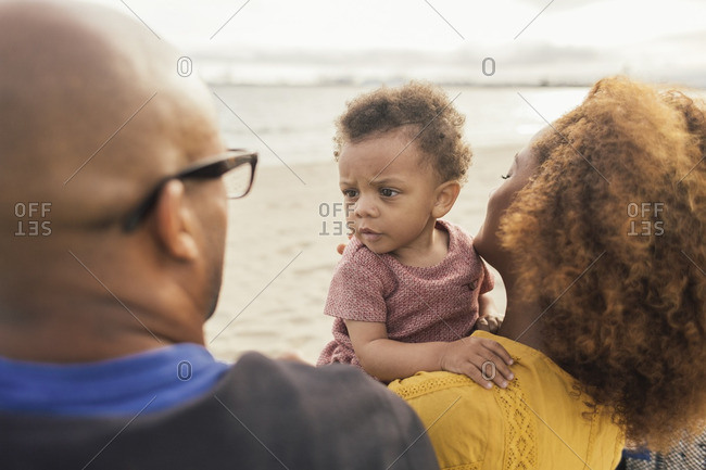 Parents with baby girl on beach