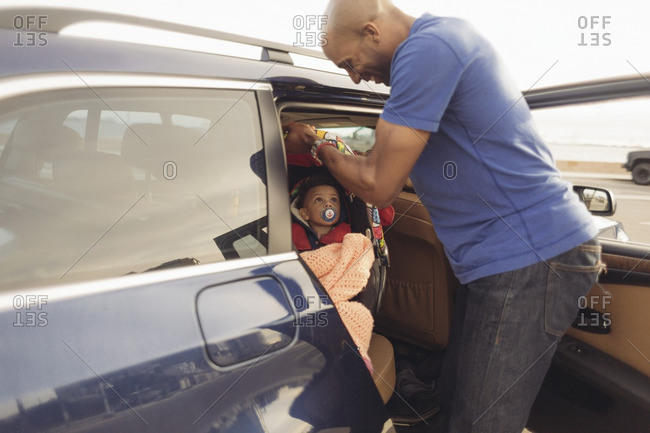 Father holding car seat with baby