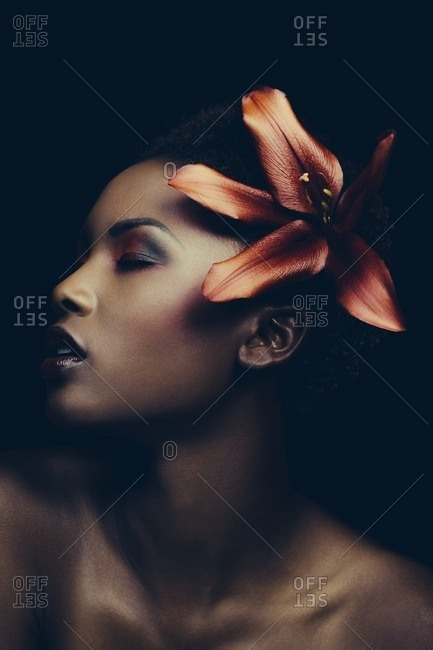 Model with flower in hair