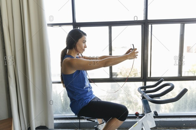 Woman taking a selfie on stationary bike