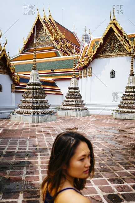 Bangkok, Thailand - March 28, 2016: Woman in Buddhist complex, Thailand