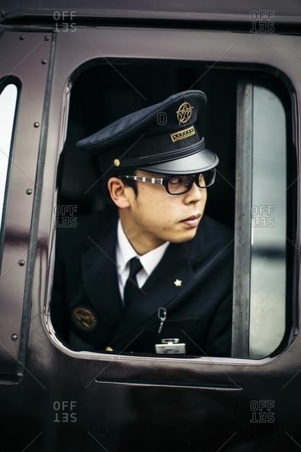 Kyushu, Japan - November 22, 2015: A train conductor in Japan
