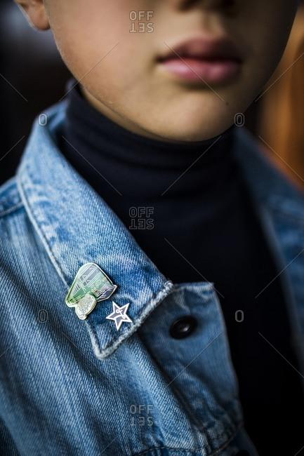 Kyushu, Japan - November 22, 2015: Japanese boy with train pins on jacket