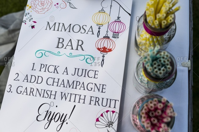A sign for a mimosa bar