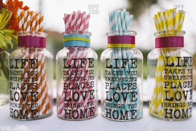 Straws in decorative jars