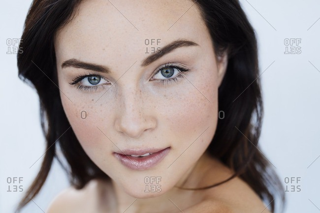 Portrait of woman with freckles