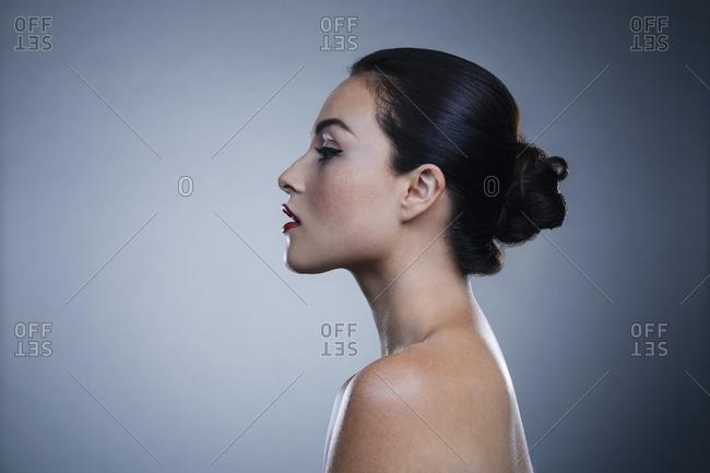 Profile portrait of woman in studio