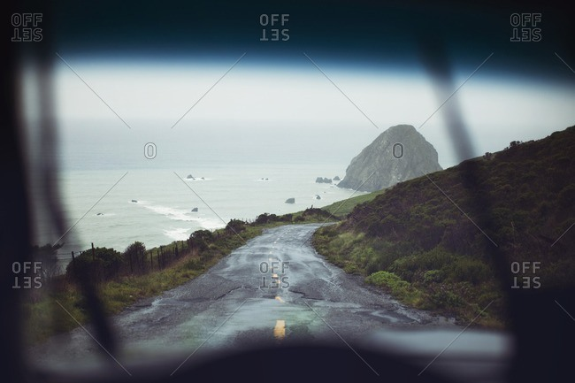 Scenic view of sea seen through car windshield