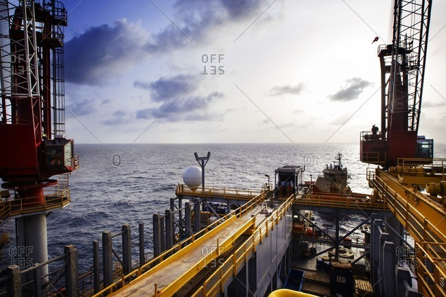 Offshore oil rig in sea against sky