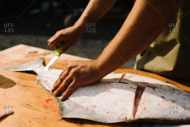 Man cleaning a freshly caught fish