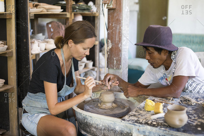 Man and woman in workshop working on pottery