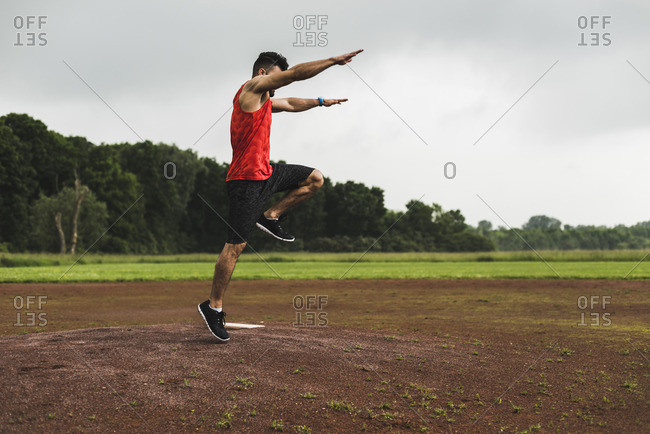 Athlete jumping on sports field