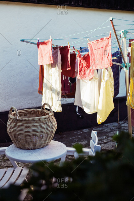 Laundries hanging on clothesline outside house