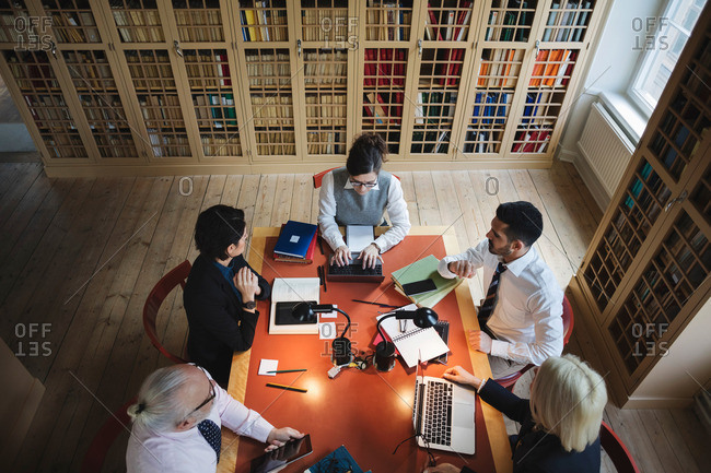High angle view of lawyers researching at table in board room