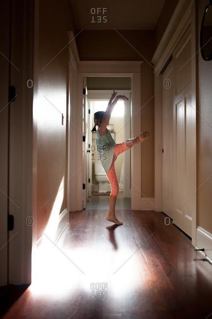 Young girl dancing in hallway