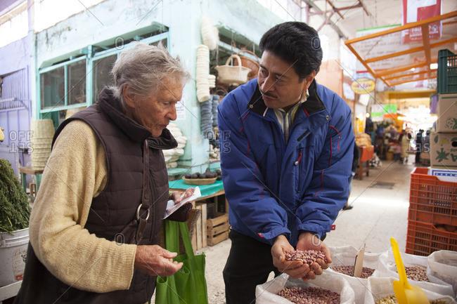 11/28/11: Woman selecting beans at market