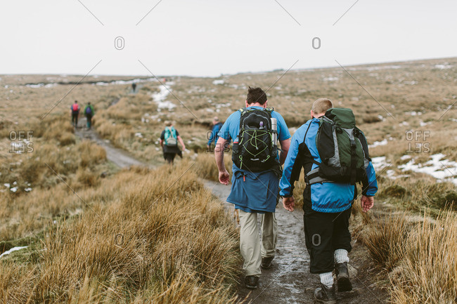People hiking across a moor in Yorkshire Dales National Park