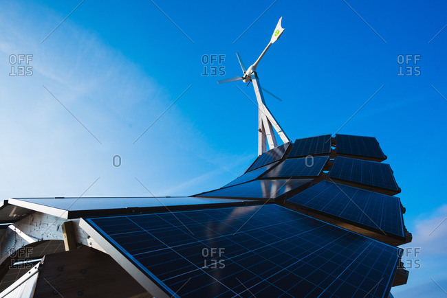 Malmo, Sweden - March 19, 2016: Low angle view of solar energy panel structure and blue sky