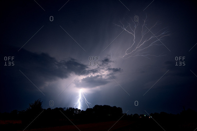 Lightning strikes the ground and spreads into the sky as a lightning crawler