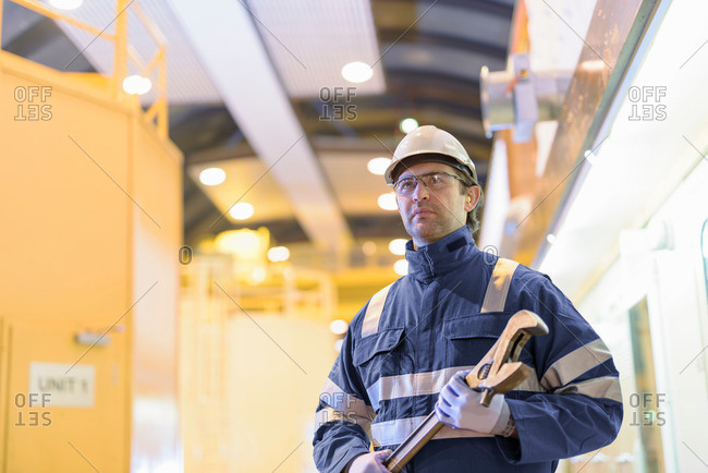 Portrait of worker in generating hall in hydroelectric power station