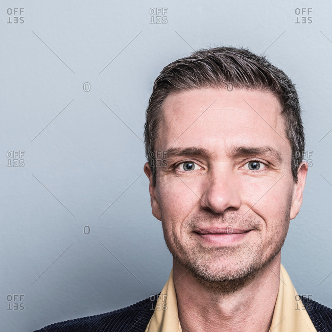Portrait of man looking ahead smiling