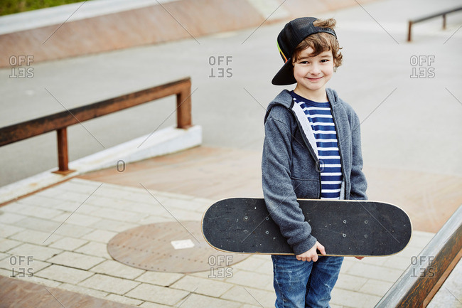 Boy skateboard looking ahead smiling