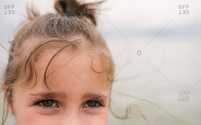 Eyes of a little girl with windblown hair