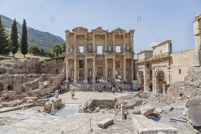 Ephesus, Turkey - August 20, 2015: Tourists get a closer look at the Library of Celsus at the ruined Roman city of Ephesus in Western Turkey