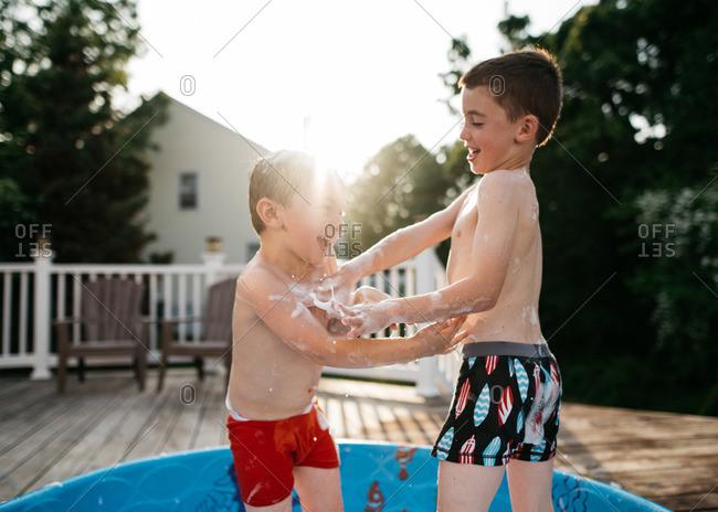 Boys goofing around in pool