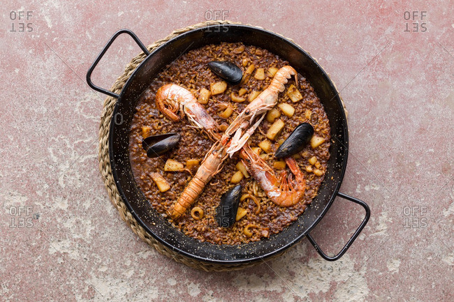 Overhead view of pot of prawns and rice