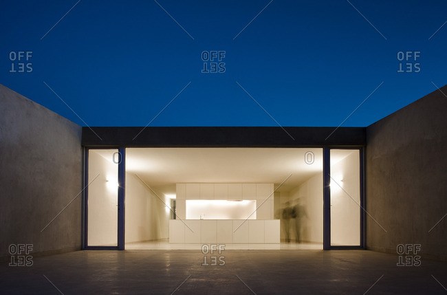 View into mountain house by Fran Silvestre set in rocks of Aroya, Valencia, Spain. Minimalist white design