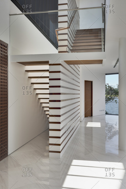 Entrance hallway and staircase in modern residential house in Sentosa Island, Singapore, Asia