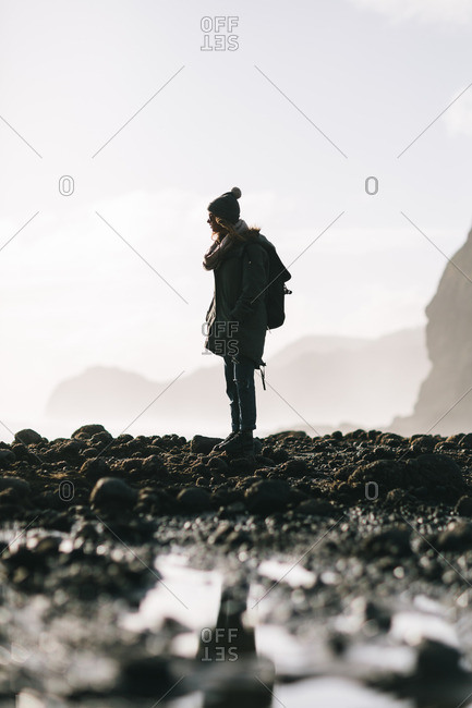 6/16/16: Female standing on rocky coast