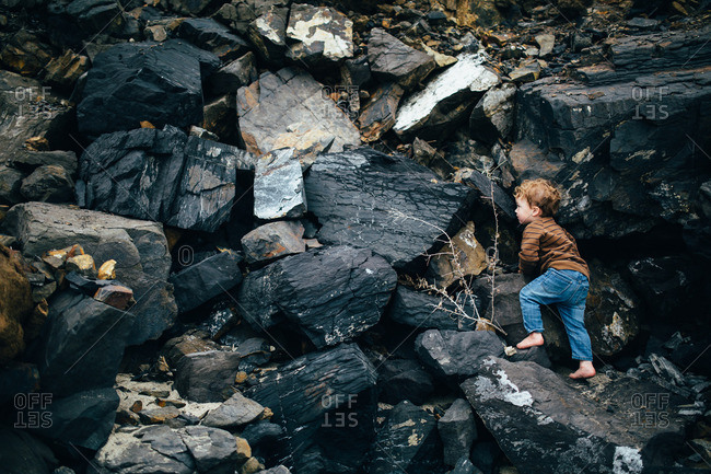 Child climbing on rocks