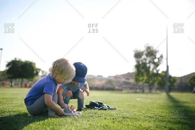 Two kids looking at shoes