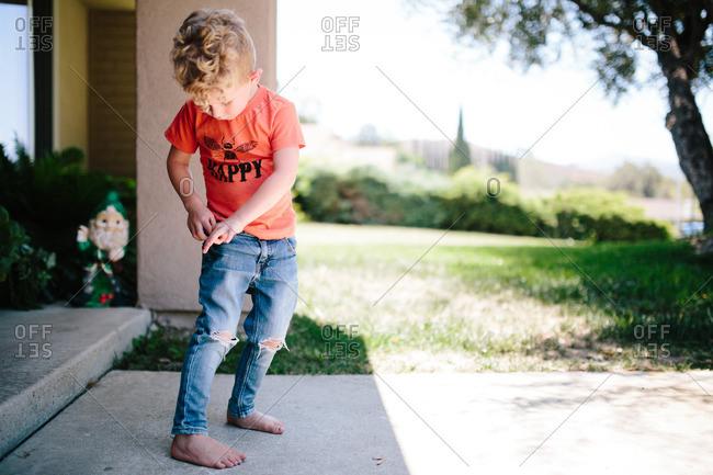 Boy looking into his pocket