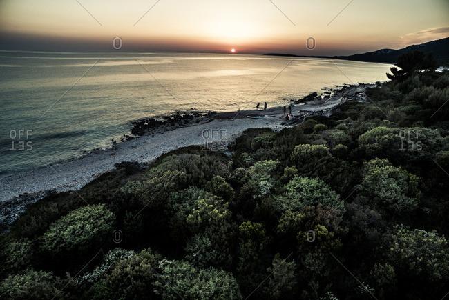 People with surfboards on Croatian coast
