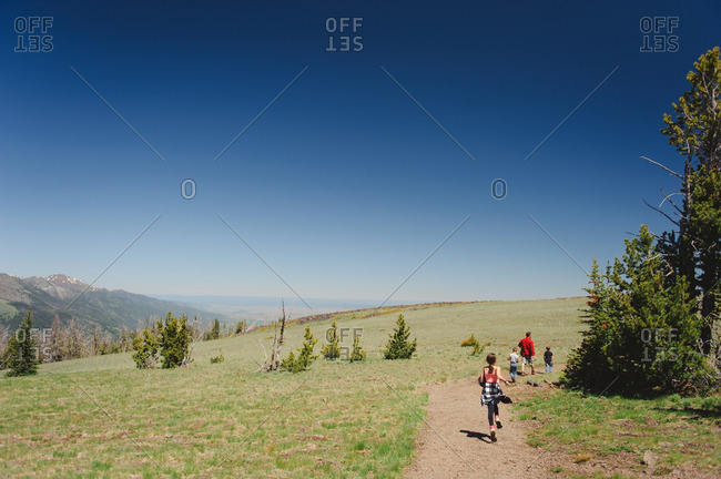 Family on a mountaintop trail