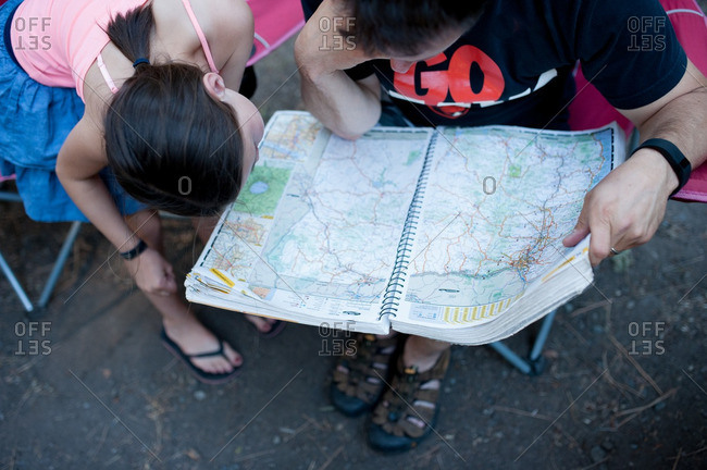 Man and girl studying map