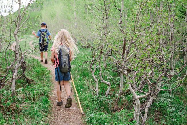 Kids with hydration packs hiking