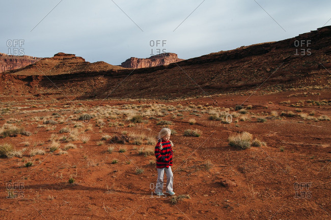 Girl by red rock formations