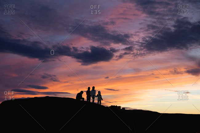 Kids in hilltop silhouette