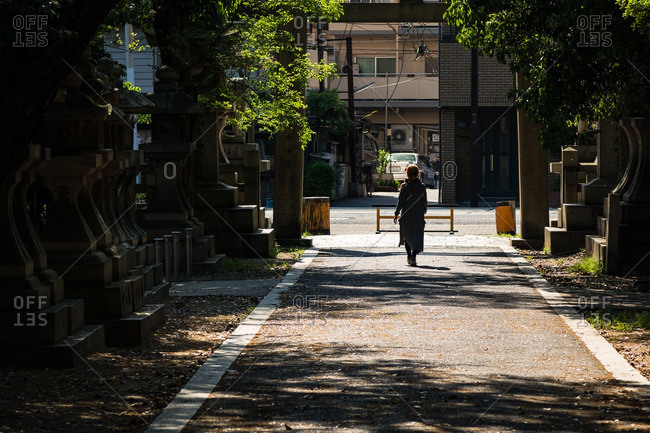 Woman by gate of Japanese temple