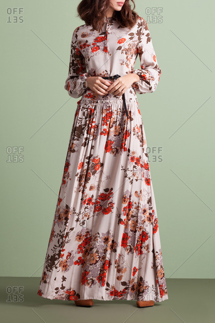 Woman in a retro floor-length floral dress