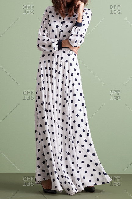 Woman in a floor-length polka dot dress