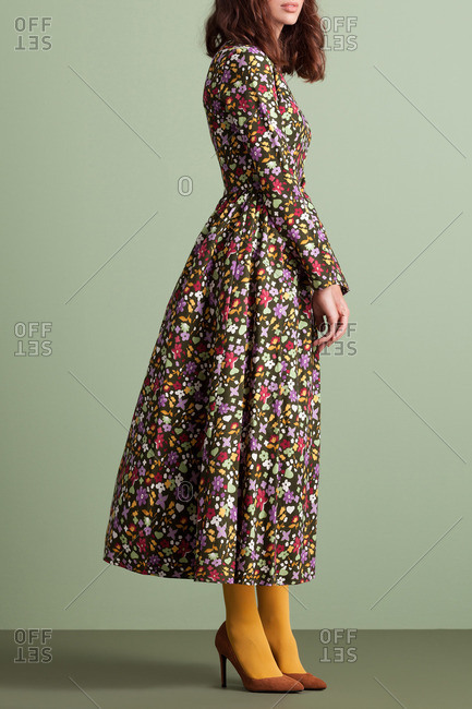 Woman in a floral ankle-length dress and yellow tights